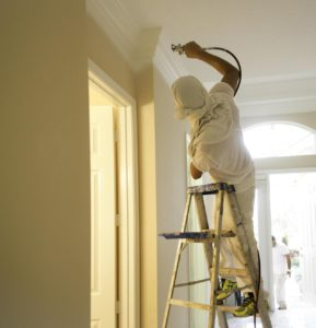 Painting in a white room with windows